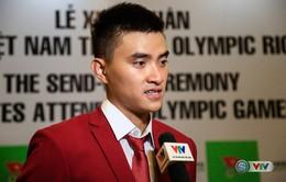 Chân dung VĐV cầm cờ cho Đoàn thể thao Việt Nam tại lễ khai mạc Olympic