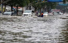 Trung Quốc nâng mức cảnh báo màu da cam với bão Nida