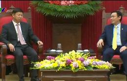 Đồng chí Vương Đình Huệ tiếp đặc phái viên của Chủ tịch Trung Quốc