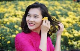 BTV Khánh Trang dịu dàng trong tà áo dài