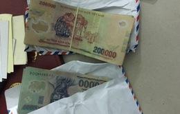 Nghệ An: Tạm giữ hai người tự xưng phóng viên nghi nhận tiền trái pháp luật