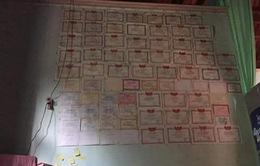 Câu chuyện ý nghĩa về bức tường 10 năm dán đầy giấy khen