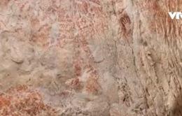 Xác định được niên đại của bức tranh lâu đời nhất thế giới trong hang động Indonesia