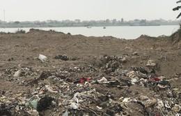 Vụ chôn lấp 10.000 m3 rác thải ven sông Thái Bình: Chưa tìm ra thủ phạm