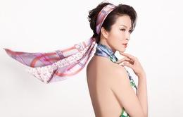 Quấn khăn làm áo, MC Thanh Mai khoe vẻ đẹp nóng bỏng ở tuổi 46