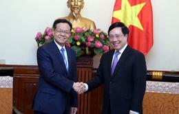 Phó Thủ tướng Phạm Bình Minh tiếp Chủ tịch Khu tự trị dân tộc Choang Quảng Tây