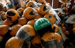 Nhân viên Grab làm việc ngày đêm để tiếp quản Uber