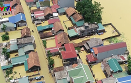 Hơn 100 nhà dân ở Bùi Xá, Hà Nội vẫn ngập trong nước