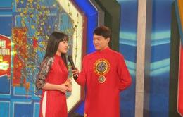 MC Trần Ngọc diện áo dài đỏ rực rỡ trong Hãy chọn giá đúng số Tết