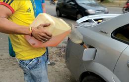 Venezuela áp mức trần lượng xăng với từng loại phương tiện vận tải