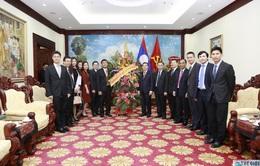 Thứ trưởng Ngoại giao Nguyễn Minh Vũ chúc mừng Quốc khánh CHDCND Lào