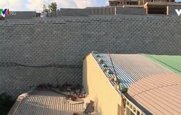 Sẽ tháo dỡ tường khổng lồ trái phép tại dự án Đồi Xanh