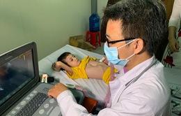 Ngô Quốc Minh - cậu bé 2 lần đứng trước bàn cân sinh tử