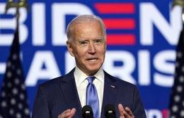 Ông Biden thúc đẩy mức lương tối thiểu lên 15 USD/ giờ