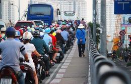Thí điểm đóng mở dải phân cách theo giờ nút giao cầu Nguyễn Tri Phương từ 29/5