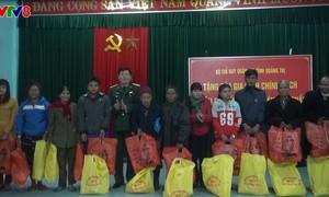 Lực lượng vũ trang các tỉnh thành chăm lo Tết cho đồng bào nghèo