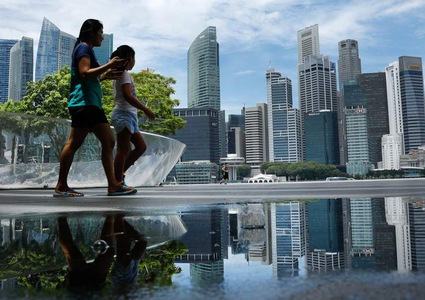 Singapore cuts growth outlook as trade war ripples across region