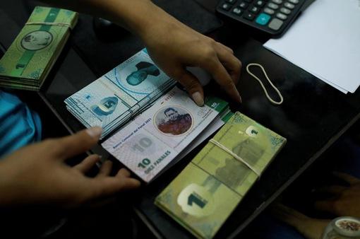 Venezuela: Thiếu hụt tiền mặt, một cộng đồng tự phát hành tiền riêng
