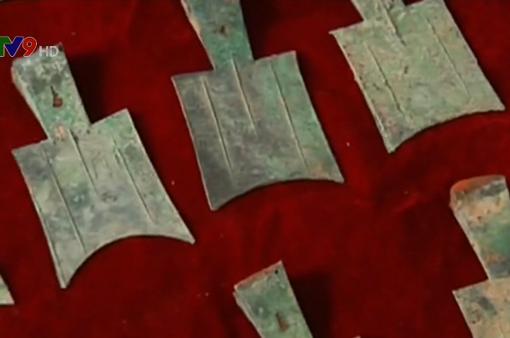 Trung Quốc phát hiện đồng xu kim loại đầu tiên