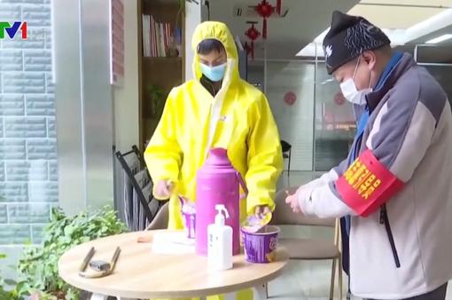Các tình nguyện viên Trung Quốc nỗ lực hỗ trợ đối phó dịch viêm phổi cấp