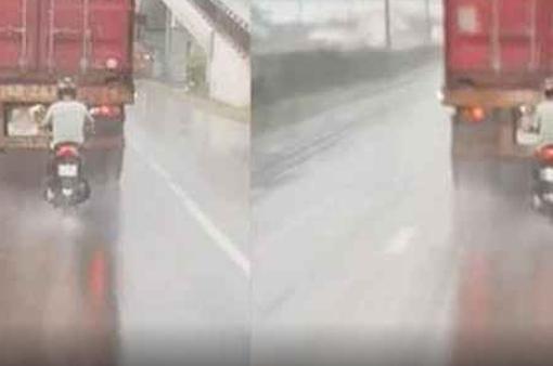 Nguy hiểm bám đuôi container để trú mưa