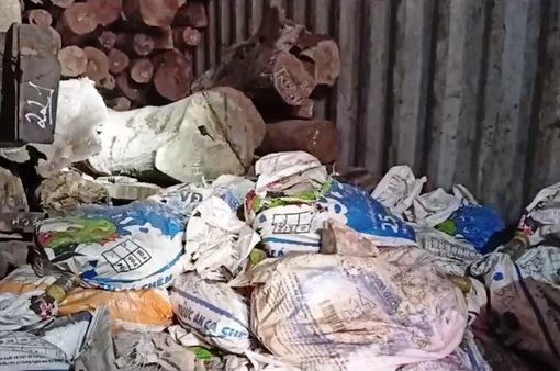 Gia cố vách ngăn trong container để vận chuyển lậu gỗ và đá quý