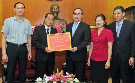 Lào hỗ trợ Việt Nam khắc phục hậu quả thiên tai