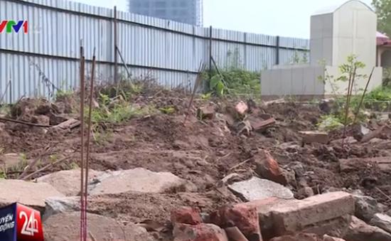 Gần 40 ngôi mộ bỗng dưng bị di dời để phục vụ dự án bãi đỗ xe