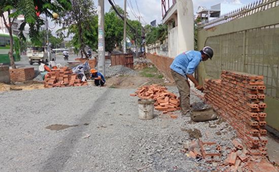 TP.HCM tạm dừng thi công nâng cao đường Kinh Dương Vương