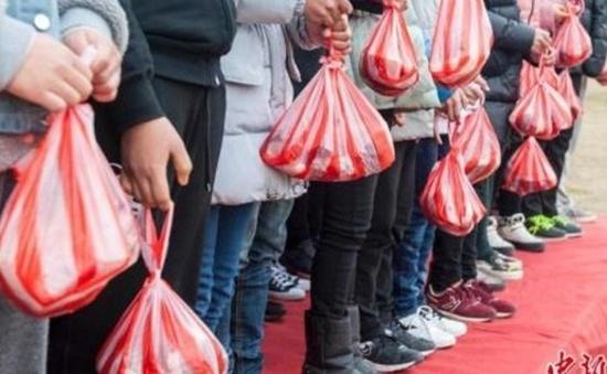 Trung Quốc thưởng thịt lợn cho học sinh xuất sắc