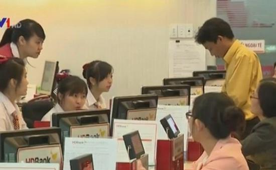 Người dân hạn chế gửi ngoại tệ tại ngân hàng
