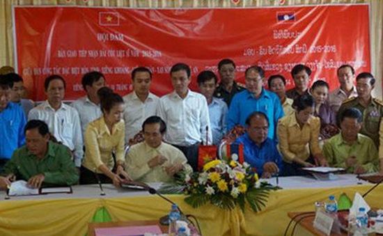 An táng 65 hài cốt liệt sỹ Việt Nam hy sinh tại Lào