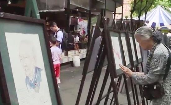 Triển lãm 100 bức tranh chân dung Mẹ Việt Nam anh hùng tại TP.HCM