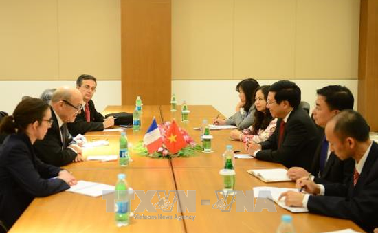PTTg Phạm Bình Minh tiếp xúc song phương trong khuôn khổ Hội nghị Bộ trưởng Ngoại giao ASEM