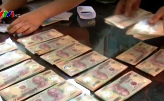 Gia tăng tình trạng buôn bán vận chuyển tiền giả ở biên giới