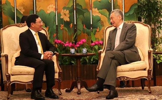 Phó Thủ tướng Phạm Bình Minh hội kiến Tổng thống và Thủ tướng Singapore