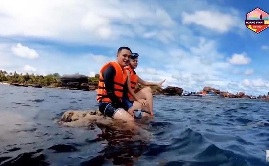 Quang Vinh, Phạm Quỳnh Anh bị chỉ trích vì ngồi trên tảng san hô sống