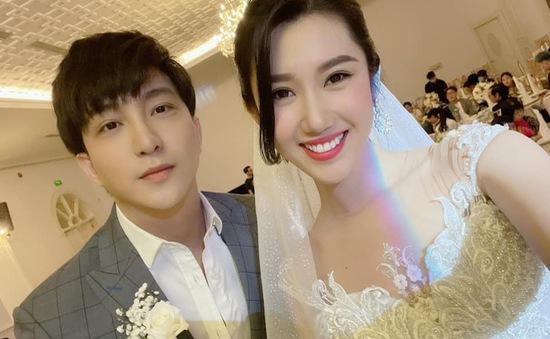 Thúy Ngân diện váy cưới hạnh phúc bên B Trần