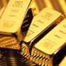 Giá vàng thế giới bật tăng gần 1%