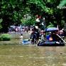Học sinh miền núi phía Bắc đội mưa, vượt lũ đi thi THPT quốc gia
