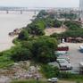 Đổ phế thải lấn sông Hồng