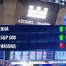 Chứng khoán Mỹ đi ngang sau quyết định hạ lãi suất của FED