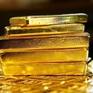 Vượt ngưỡng 1.800 USD/ounce, giá vàng lên đỉnh 9 năm
