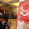 Người dân Trung Quốc thay đổi quan niệm đón Tết trong mùa COVID-19