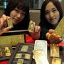 Đồng USD hấp dẫn nhà đầu tư, giá vàng châu Á giảm